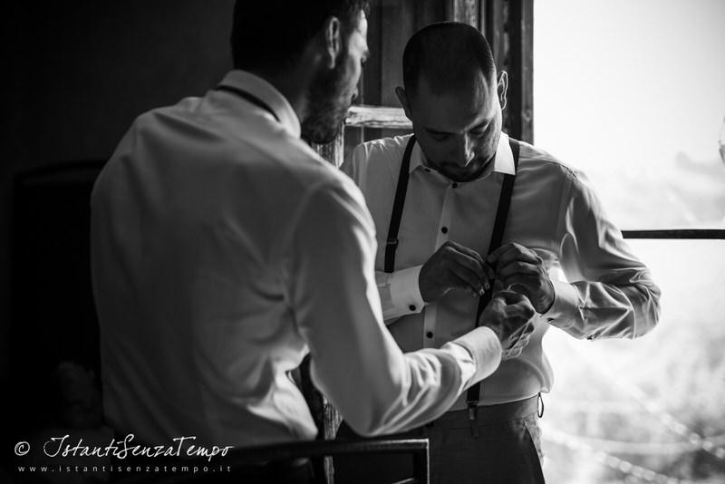 A moment of a Groom getting ready