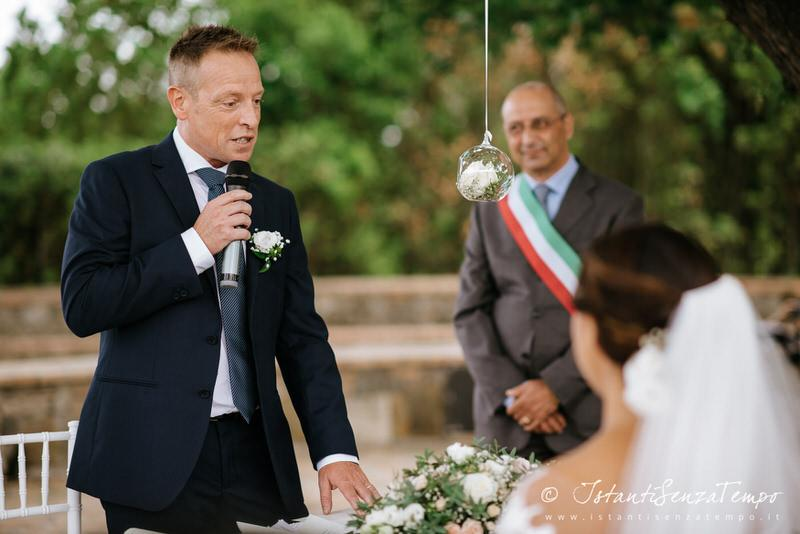 A guest speaking to Bride and Groom