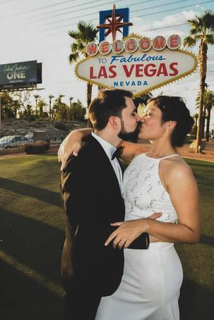 A romantic kiss under Las Vegas sign