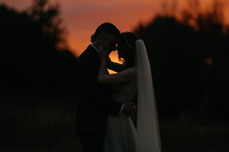 Portrait of wedding couple at sunset